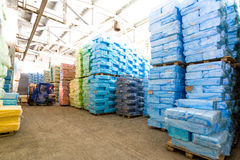 Storage at factory with wrapped in plastic boxes royalty free stock photo