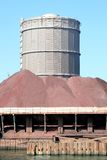 Storage of iron ore near steel factory. In IJmuiden (the Netherlands) along the North Sea Channel you can find Europe's second largest steel producer. Factory stock photography