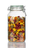 Storage jar with colorful Pasta Noodles with real reflection Royalty Free Stock Photos