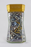 Storage jar with old screws Royalty Free Stock Images