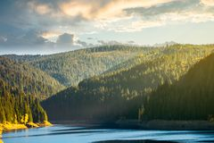 Storage lake reservoir in mountain. Beautiful autumn landscape at sunrise royalty free stock photos