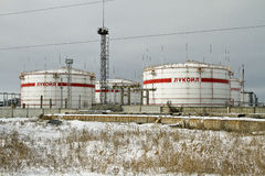 Storage of light petroleum products on the territory of the refinery, with the inscription LUKOIL. Stock Image