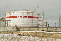 Storage of light petroleum products on the territory of the refinery, with the inscription LUKOIL. Royalty Free Stock Photography
