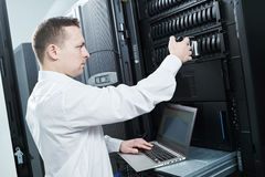 Storage maintenance. Service engineer in server room stock images