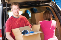 Storage: Man Carrying Box Stock Photography