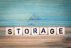 Storage - name from wooden letters. Office desk, informative and communication background stock image