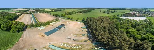 Storage place of a farm in Germany, composite panorama of high resolution aerial photos. Composite panorama of high resolution aerial photos of a farming storage stock image