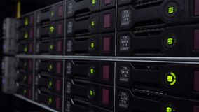 Storage racks with many hard drives in room of data center. HDD SATA. Side view. Side view. Storage racks with many hard drives in room of data center. HDD SATA stock video footage