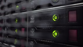 Storage racks with many hard drives in room of data center. HDD SATA stock video