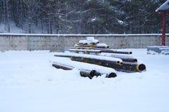 Storage racks of metallic pipes of different diameters Stock Photos