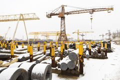 Storage of reinforcing steel rolls and metal bars. On open yard Stock Images