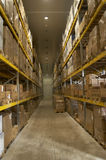 Storage room. Interior of storage of boxes stack  in a factory Royalty Free Stock Photo