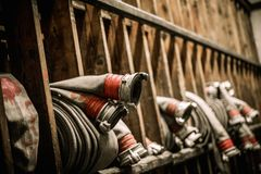 Storage room in firefighting depot. With water hoses stock photos