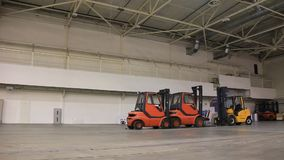 Storage room and forklift loaders Royalty Free Stock Image