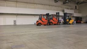 Storage room and forklift loaders Royalty Free Stock Photography
