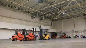 Storage room and forklift loaders Royalty Free Stock Photos