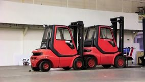 Storage room and forklift loaders Stock Photography