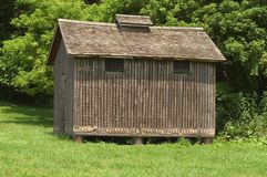 Storage shed. On a farm.  Siding is see through.  Building is located next to the barn Royalty Free Stock Images