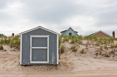 Storage Shed on Beach. A storage shed in front of dunes on a beach Royalty Free Stock Photography