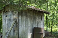 Storage shed at the edge of a forest royalty free stock photo