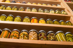 Storage shelves with canned food. Storage shelves in pantry with homemade canned preserved fruits and vegetables Stock Photos