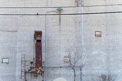 Storage Silo Wall and Chute. External wall of grain storage silo and chute Stock Photo