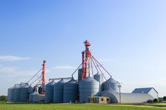 Storage silos. Modern grain storage silos taken during a sunny summer day Stock Photos