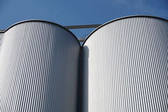 Storage silos against blue sky for beer processing Royalty Free Stock Photography