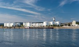 Storage silos,fuel depot of petroleum and gasoline on the banks of the river in western Germany on a beautiful blue sky with cloud stock photography
