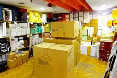 Storage space. Small storage space full of cardboard boxes Royalty Free Stock Photos