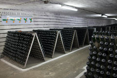 The storage of sparkling wine in a wine cellar. Stock Photography
