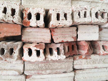 The storage stack bricks. Clay bricks are maintained by switching the direction of lay stacked in rows Stock Images