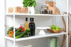 Storage stand with kitchenware and food stuff,. Indoors royalty free stock photos