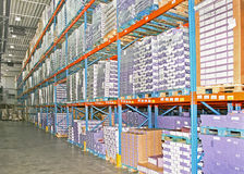 Storage stock. Big warehouse storage room with boxes and shelves Stock Photo