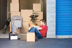 Storage: Taking a Break From Lifting. Caucasian man and woman with various props at a typical commercial storage unit Royalty Free Stock Images