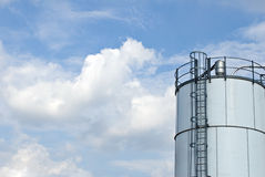 Storage Tank with Cloudscape Stock Photography