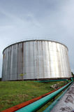 Storage tank of crude oil. Was photographed  in an oil mining area Royalty Free Stock Photo