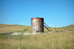 A storage tank for oil in the prairies Royalty Free Stock Photos