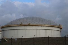 Storage tank at refinery in Rotterdam to store oil of fuel in the Netherlands. Storage tank at refinery in Rotterdam to store oil of fuel in the Netherlands royalty free stock photo