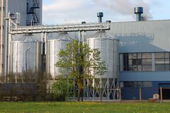 Storage tanks. Three shiny steel storage tanks, industrial background Stock Image