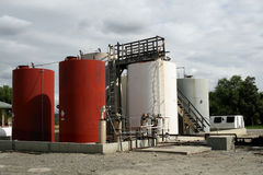 Storage Tanks. A cluster of storage tanks stands in a rural area Stock Image