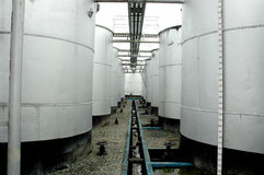 Storage tanks of crude oil. Was photographed  in an oil mining area Stock Photos