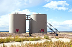 Storage tanks for crude oil. Location tanks to hold crude oil as it is pumped and treated to remove water Royalty Free Stock Photography