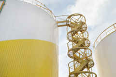 Storage tanks of industrial oil mill. Cylindrical storage tanks of an industrial oil mill with stairs Stock Images