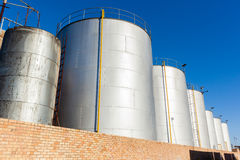 Storage Tanks Liquids. Storage tanks steel plated for industrial factory  liquids Royalty Free Stock Photos