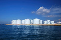 Storage tanks at a refinery in Singapore. Group of storage tanks at a refinery in Singapore Stock Image