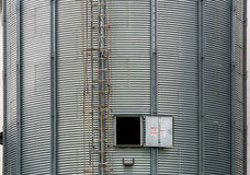 storage tanks in rice mill, factory process production line in t Stock Photos