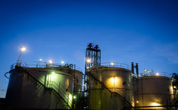 Storage tanks at twilight Stock Photography