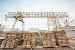 Storage timber crane. Lumber industry Stock Images