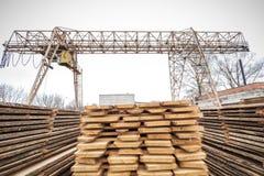 Storage timber crane. Lumber industry Stock Photo